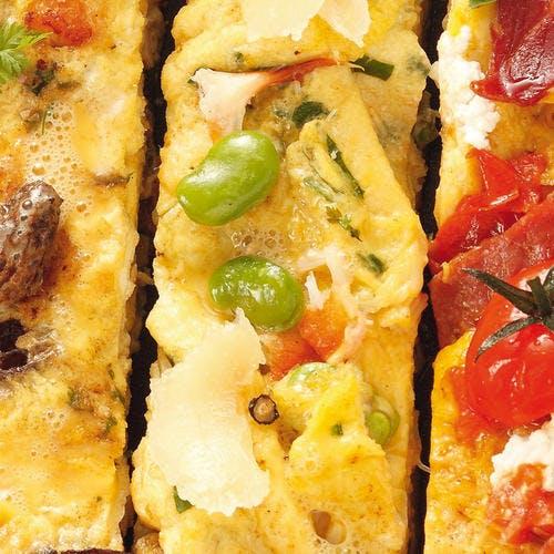 Omelette au crabe, aux fèves et au pecorino
