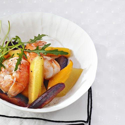 Wok de carottes nouvelles au miel, langoustines du Guilvinec et poivre des cimes