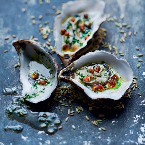 Huîtres gratinées au beurre d'herbes anisé