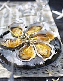 Huîtres en vinaigrette chaude de pamplemousse