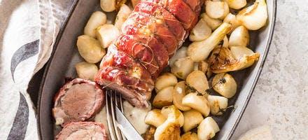 Rôti de porc farci au Reblochon en croûte de jambon cru