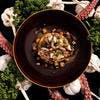 Poulpe grillé à la persillade, écrasée de potimarron au chorizo bellota