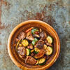 Tajine de boeuf épicé aux légumes et aux amandes