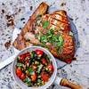 Espadon grillé aux herbes fraîches, sauce tiède aux tomates cerises, olives, câpres et pignons